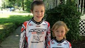 Cassidy Hall with her brother, Johnny, who also is a BMX racer. / CAROL KELLY/STAFF PHOTO