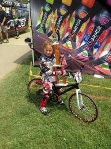 Five-year-old BMX racer Cassidy Hall holding her trophy after finishing first in her age group at the East Coast BMX Nationals in Maryland in June. / Photo courtesy of John Hall